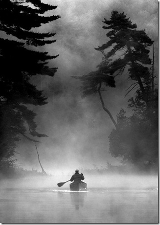 canoeing down river in fog