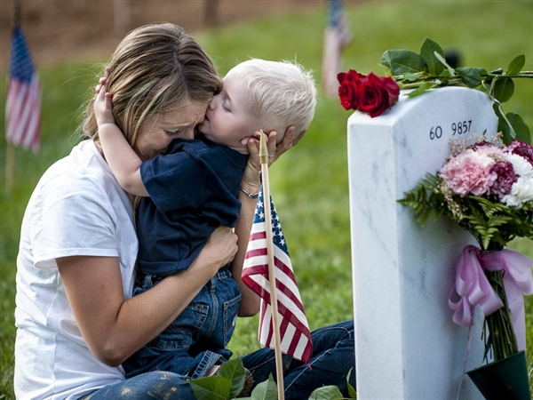 Mother, son, mourning father, grave site