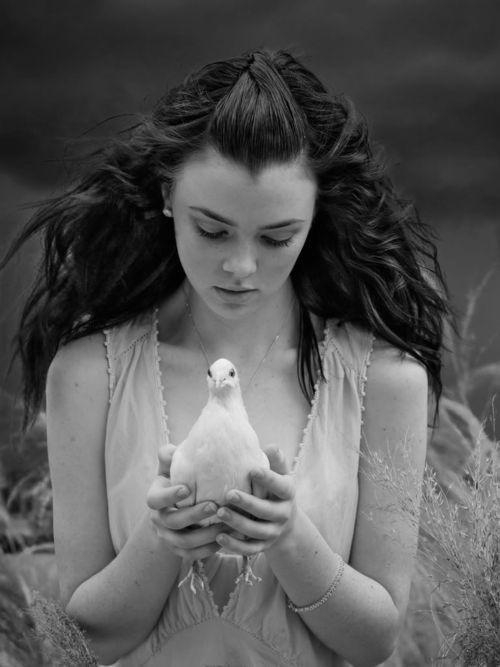 Portrait of Woman Holding Dove