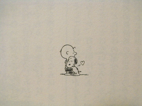 charlie brown hugging snoopy