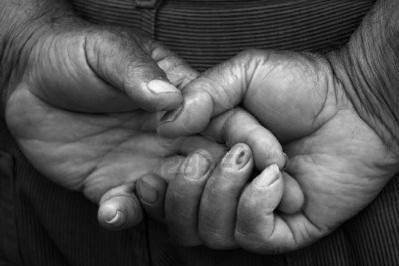 13473651-male-hands-close-up-black-and-white