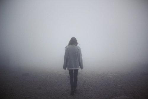 walking away in mist