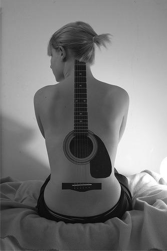 woman-tattoo-guitar