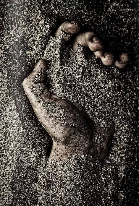 hand-sand-earth