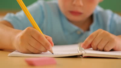 child-writing-at-school