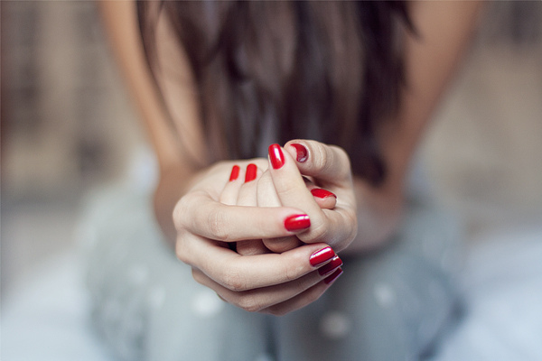 sit-rest-hands-nails-red