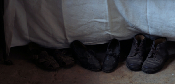 shoes-foot-of-bed